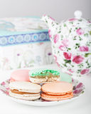 Traditional French sweets Macrons against tea set Royalty Free Stock Photo