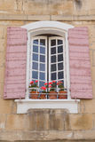 Traditional French window with pink shutters Stock Photography