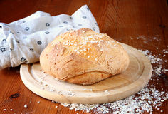 Traditional fresh bread on wooden table Stock Images