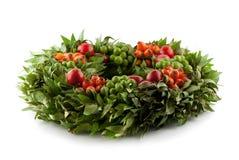 Traditional fresh holi wreath, isolated on white. Background Royalty Free Stock Photography