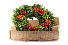 Traditional fresh holi wreath, isolated on white. Background Stock Photo