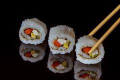Traditional fresh japanese sushi rolls on black background. Traditional fresh japanese sushi rolls on a black background Stock Photos