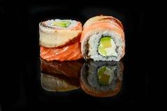 Traditional fresh japanese sushi rolls on a black background stock image