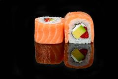Traditional fresh japanese sushi rolls on a black background stock photos