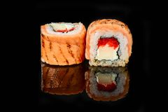Traditional fresh japanese sushi rolls on a black background royalty free stock photos