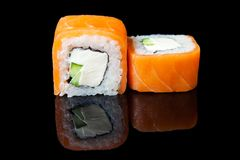 Traditional fresh japanese sushi rolls on a black background. With reflection Royalty Free Stock Photo
