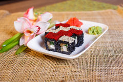 Traditional fresh japanese sushi rolls on a black background Royalty Free Stock Photography
