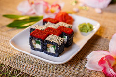 Traditional fresh japanese sushi rolls on a black background Royalty Free Stock Images