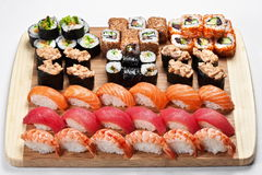 Traditional fresh japanese sushi rolls set on a wooden board Royalty Free Stock Images