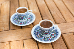 Traditional fresh turkish coffee on wooden table Royalty Free Stock Photo