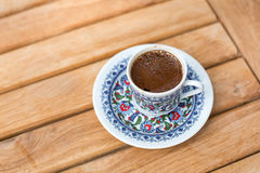Traditional fresh turkish coffee on wooden table Royalty Free Stock Images