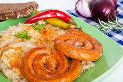 Traditional fried sausage and sauerkraut Stock Photo