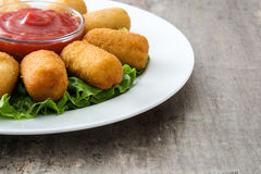 Traditional fried Spanish croquetas croquettes with ketchup in plate Royalty Free Stock Images
