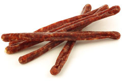 Traditional frisian dried sausage sticks. On a white background Stock Image