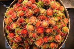 Rambutan on the counter market. Traditional fruit Rambutan on the counter market in Thailand Royalty Free Stock Image