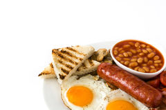 Traditional full English breakfast with fried eggs, sausages, beans, mushrooms, grilled tomatoes and bacon Royalty Free Stock Images