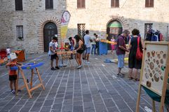 Traditional games in the medieval village of Staffolo in Italy. 19 August 2018, Event: reconstruction of medieval games in the historic center of the village of stock photography