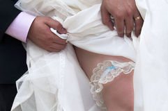 Traditional garter on a brides leg Stock Photography