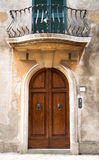 Traditional Gate under the Balcony. In Italy royalty free stock images