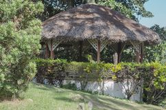 Traditional gazebo roofed in palm tree mountains to enjoy the cool breeze and landscape stock images