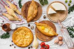 Traditional Georgian adjara khachapuri and Kolkh khachapuri on the table. Homemade baking. Top view. Flat lay.  Stock Images