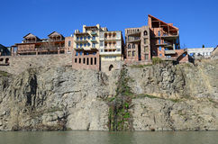 Traditional georgian architecture - beautiful buildings on the steep shore over the Kura River in Metekhi district. Tbilisi Royalty Free Stock Photo