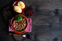 Traditional georgian dish lobio. Traditional georgian red beans dish lobio with pomegranate on rustic table with copy space royalty free stock photos