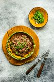 Traditional georgian dish lobio. Traditional georgian red beans dish lobio with pomegranate on rustic table with copy space royalty free stock images