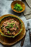 Traditional georgian dish lobio. Traditional georgian red beans dish lobio with pomegranate on rustic table with copy space stock photo