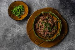 Traditional georgian dish lobio. Traditional georgian red beans dish lobio with pomegranate on rustic table with copy space stock images