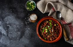 Traditional georgian dish lobio. Traditional georgian red beans dish lobio with pomegranate on rustic table with copy space royalty free stock photography
