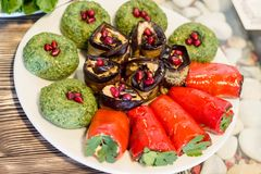 Traditional georgian food : Badridani Badridani and stuffed vegetables wit a lot of coriander royalty free stock images
