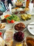 Traditional Georgian table for dear guests. Traditional home-style Georgian table for dear guests, narrow focus area stock photos