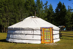 A traditional ger in Mongolia. A traditional yurt (from Turkic) or ger (Mongolian) is a portable, round tent covered with skins or felt used as a dwelling by Stock Photography