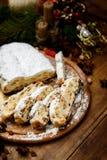 Traditional German cake with raisins Dresdner stollen. Christmas treat stock image