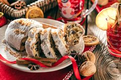 Traditional German Christmas cake - Cranberry Stollen, Christmas tree, ornaments, and candles stock image