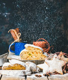 Traditional German Christmas cake Stollen with festive gingerbread star-shaped cookies Stock Photo