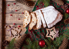 Traditional German Christmas cake Stollen with Marzipan, Nuts Berries and Raising. Holiday xmas celebration decorations. Stock Image