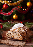 Traditional German Christmas cake Stollen on a rustic festive table. Celebration decorations. Royalty Free Stock Photos
