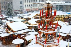 Traditional German christmas market in the historic center of Nuremberg, Germany during snow royalty free stock photography