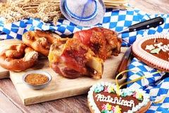 Traditional German cuisine, Schweinshaxe roasted ham hock and pretzels. Traditional German cuisine, Schweinshaxe roasted ham hock. pretzels Bavarian specialties stock image