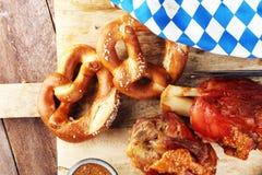 Traditional German cuisine, Schweinshaxe roasted ham hock and pretzels. Traditional German cuisine, Schweinshaxe roasted ham hock. pretzels Bavarian specialties royalty free stock photography