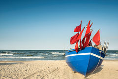 Traditional German fisherman boat on a sandy shore Stock Photos