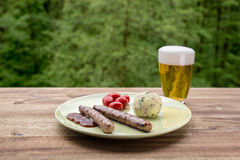 Traditional german food with sausage, dumpling, tomatos, ketchup Royalty Free Stock Photography