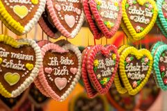 Traditional German gingerbread heart-shaped cookies. On display in candy store at Bavarian festival, Oktoberfest Stock Photos