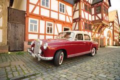 Traditional german house. Old red Mercedes car Royalty Free Stock Images