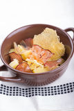 Traditional German potato salad with bacon. And cheese crisps royalty free stock image