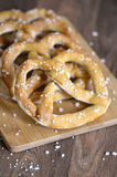 Traditional German Salted Pretzels on Serving Board Stock Photo