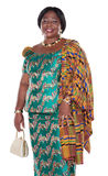 Traditional Ghana. Senior African woman with traditional Ghana clothing, green dress and white handbag Stock Photos