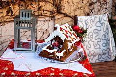 Traditional gingerbread house and lamp with candle Royalty Free Stock Image